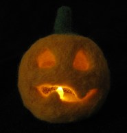 And here's the finished piece all lit up. Isn't he cute? I mean scary, they're sposed to be scary aren't they? Whoops!