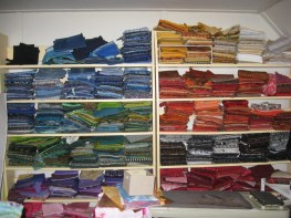 Shelves of fabric, sorted by color