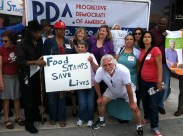 PDA members, including Advisory Board Chair Mimi Kennedy, protested food stamp cuts in front of Congressman Henry Waxman's office.