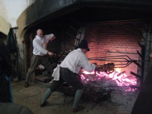 Dave strikes a heroic pose to help Ross remove the meat from the multi armed spit!