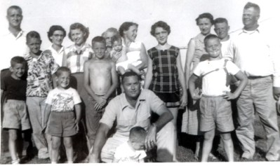 From left, Jim Moellinger, sons Jim and Terry, Imogene Victria Colvard (back) and son Harold (front), Vivian Victria Moellinger, Hank Tuell, Cora Victria (in back) Henry Tuell and son Tom (on ground in front), Eunice Tuell holding daughter Vicki, Carol Tuell, Mamie Victria Brown, sons Trumann (in front) and Adam Carl, and Adam Brown. Photo taken about 1956.