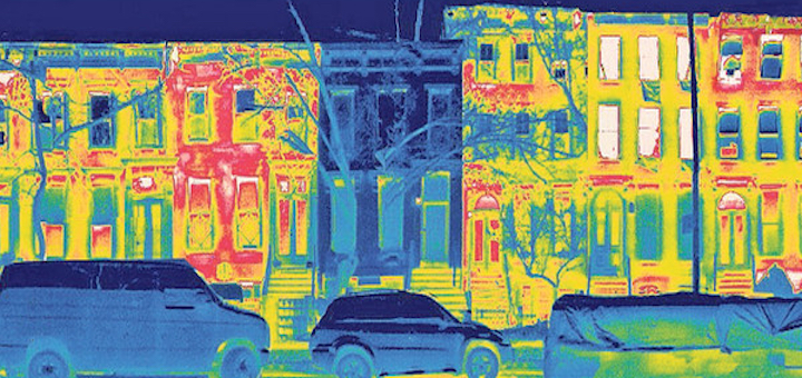 """Thermal image of Fete Nature Architecture's first certified Passive House in NYC. From architect Julie Torres Moskovitz: """"This thermal image was taken on a cold winter night and you can see that the Passive House retrofit  is retaining its heat while the other neighboring rowhouses are leaking fossil fuels out their windows, cornices, and through the facade."""""""