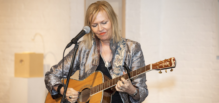 Mary Lee Kortes sings and plays the guitar