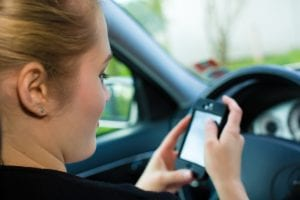 person texting while driving