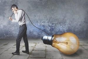 man dragging a light bulb