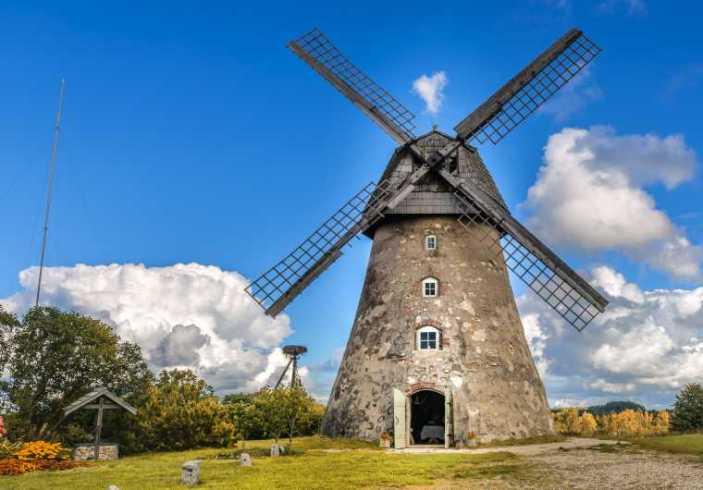 A dutch windmill against a blue sky