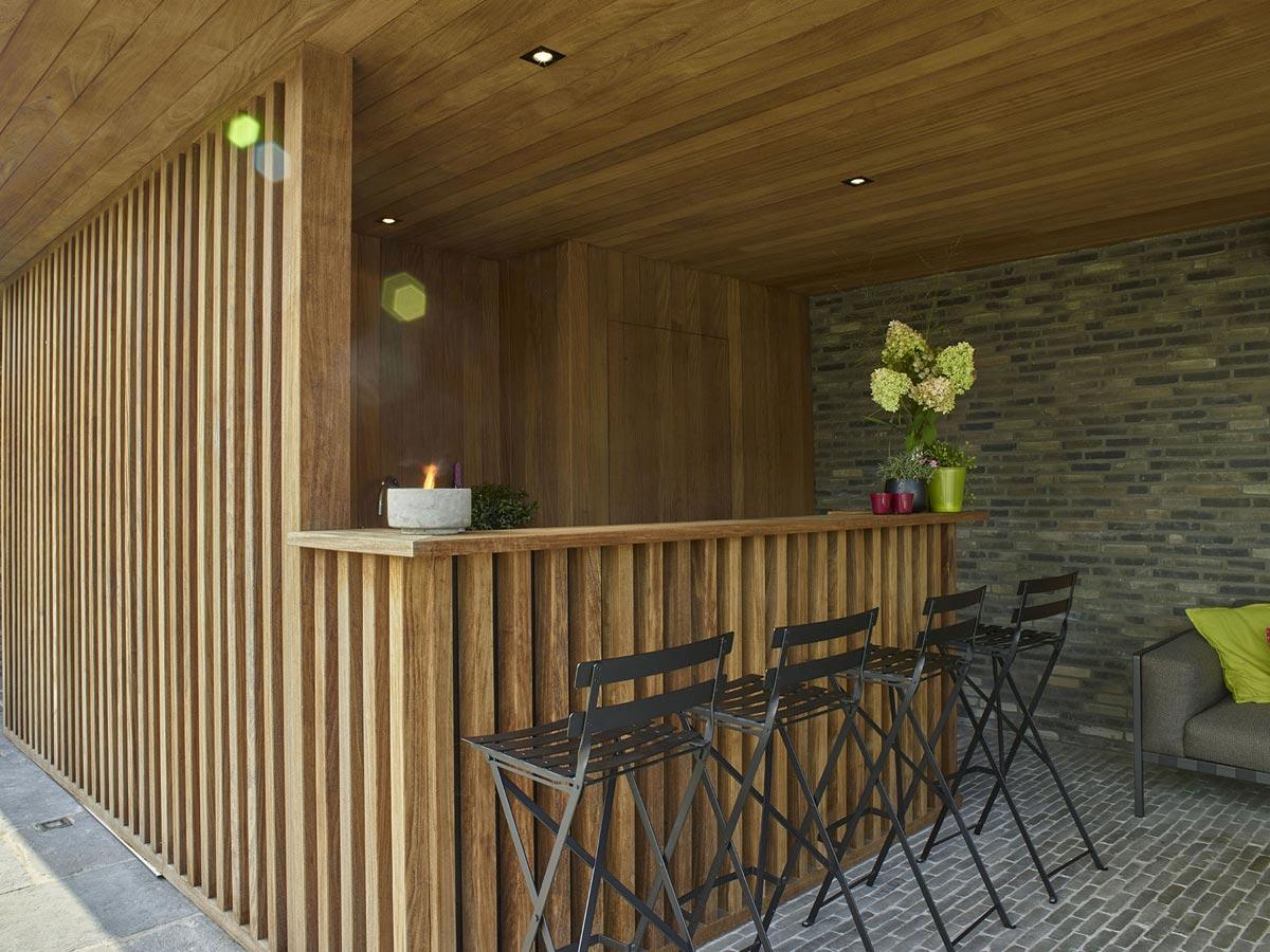 Voorbeelden van tuinaanleg terrassen paden zwemvijver