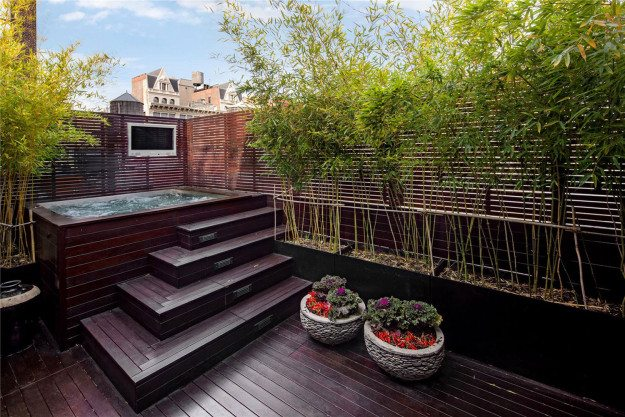 outdoor-deck-jacuzzi-soaking-tub-modern-stylish-apartment-design-with-dark-oak-flooring-tile-and-small-garden-with-bamboo-plants-ideas