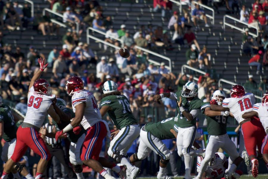 Sophomore+quarterback+Glen+Cuiellette+makes+a+play+in+the+Green+Wave%27s+game+against+SMU.%C2%A0