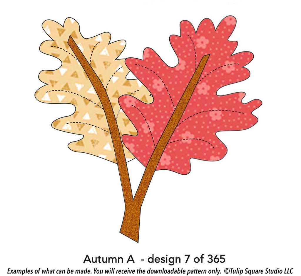 A graphic of two autumn leaves done in fabric appliqué