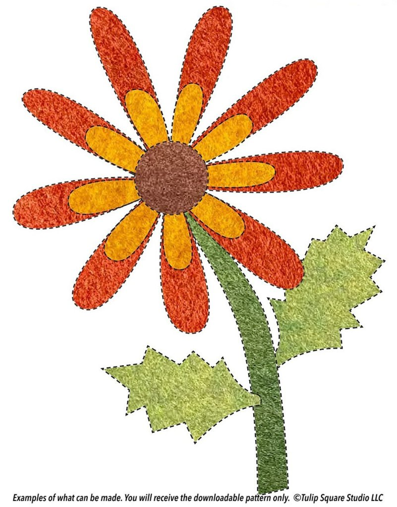 A two-toned orange flower with a brown center, on a stem with jagged leaves. Made of colored felt appliqué.