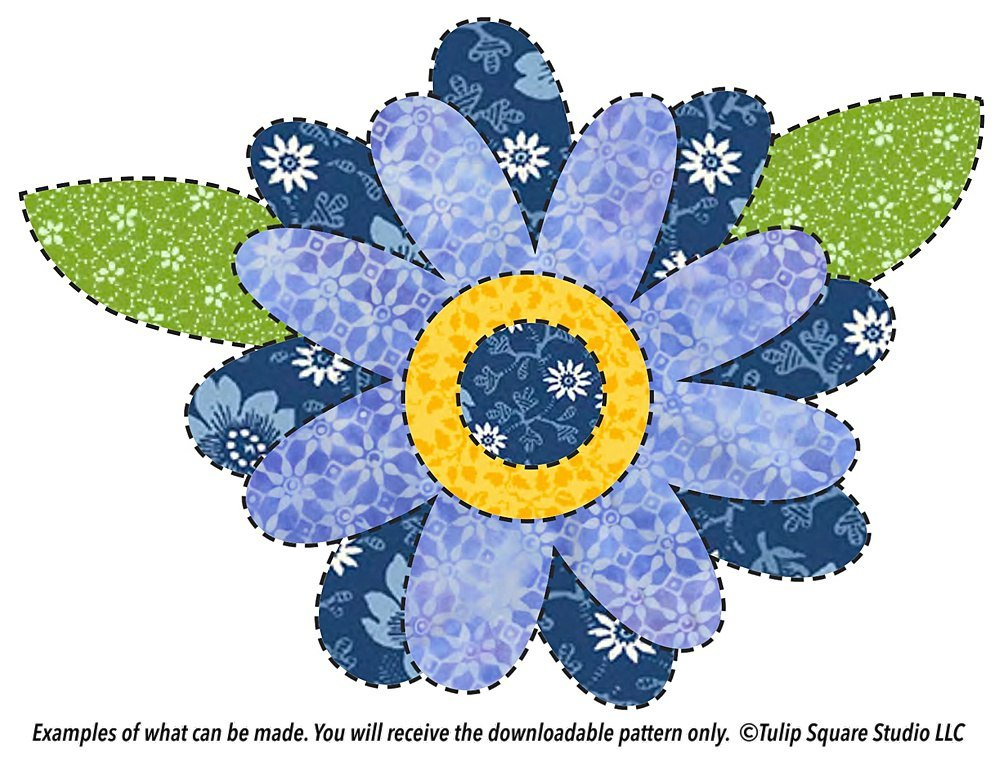 Layers of flowered fabric in shades of blue create a whimsical flower in appliqué.