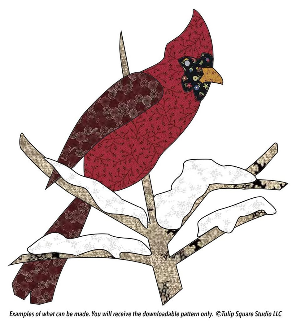 Graphic of a red cardinal on a snowy branch, appliquéd in patterned fabrics.