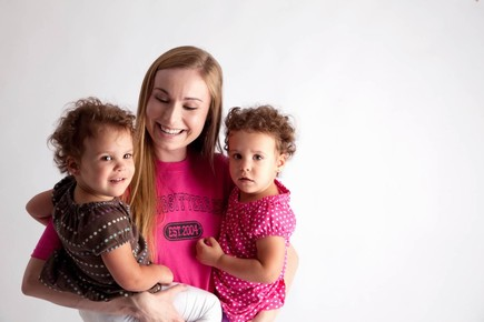 sitter-holding-twin-toddlers-standing