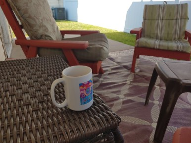 Cup of coffee and patio chairs demonstrating perspective