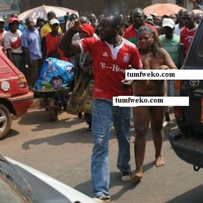 PHOTO:Mob Stripped Girl Completely Naked For Indescent Dressing