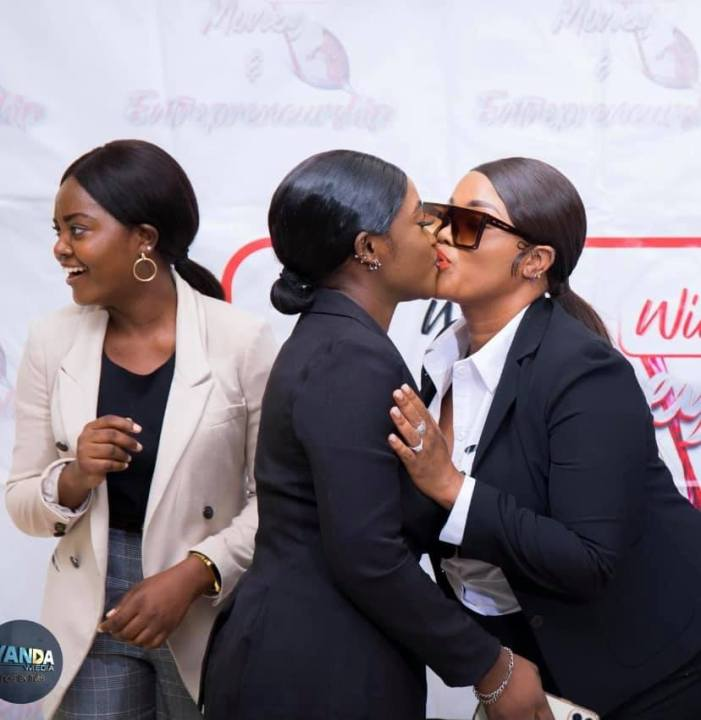 Photo: Milly Beauty kisses a friend during a women's conference over the weekend