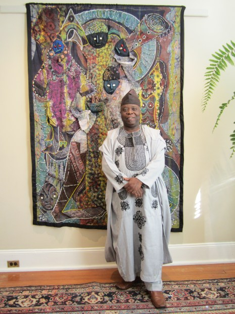 "Tunde Odunlade with ""Clarion Call,"" batik quilt tapestry (BQT)"