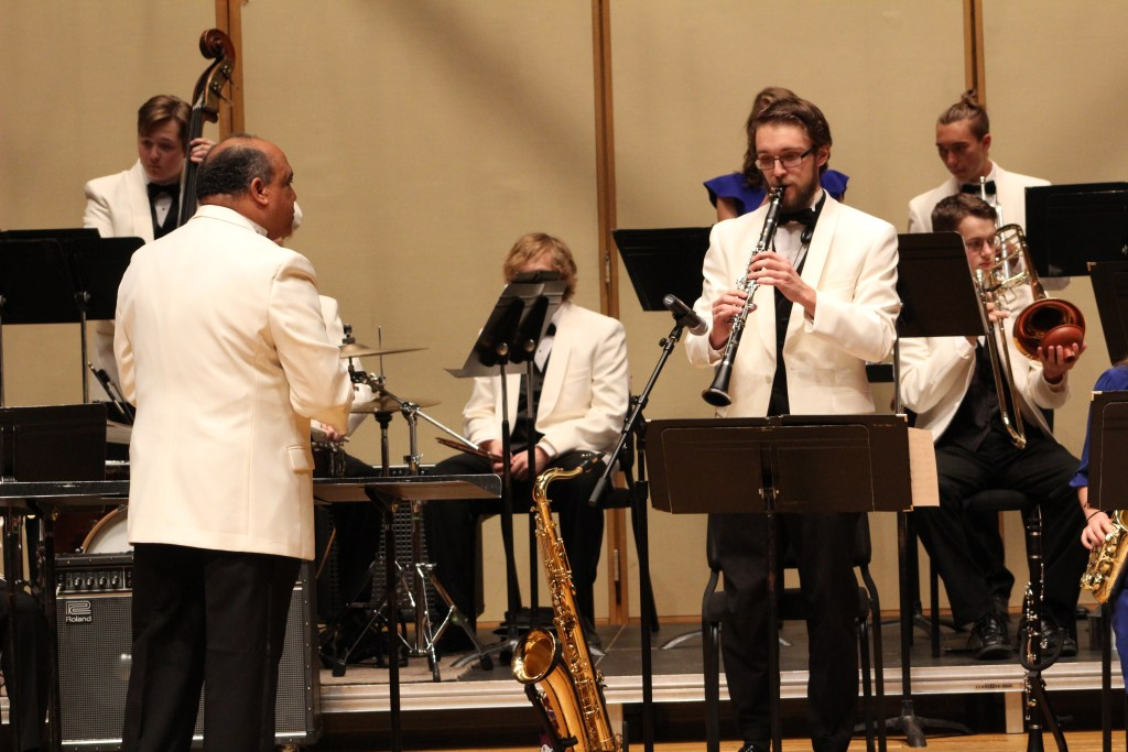 Luther College Jazz Orchestra led by Dr. Juan Tony Guzman. Tenor sax soloist is Peter Mathistad, section leader.