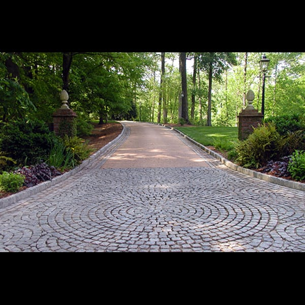 Turnaround court and driveway at a Buckhead residence in Atlanta, landscape designed by Tunnell and Tunnell Landscape Architecture.