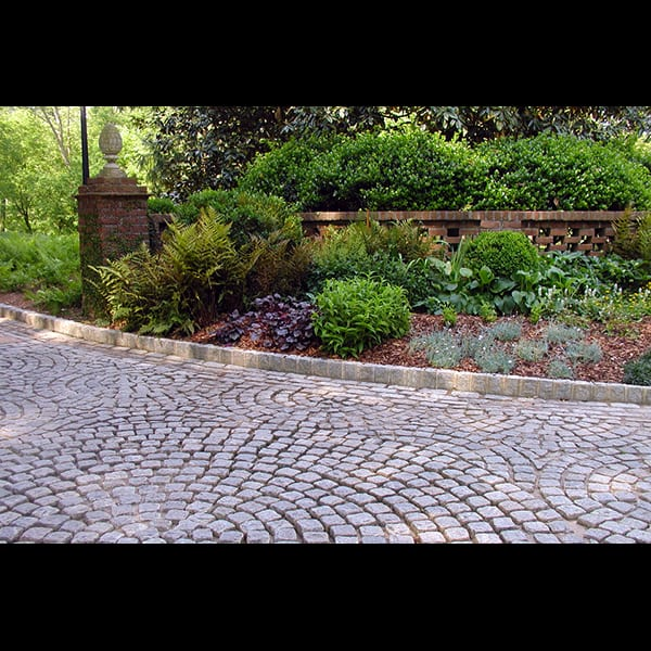 Border planting at entry gate of a Buckhead residence in Atlanta, landscape designed by Tunnell and Tunnell Landscape Architecture.