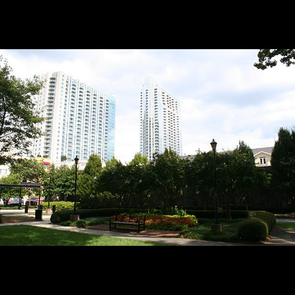 View of midtown from the rear courtyard at the Biltmore Hotel and Apartments in Atlanta, Georgia, landscape by Tunnell and Tunnell Landscape Architecture.
