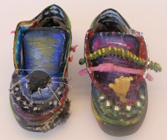These were shoes I decorated and people like them so they're here. It's made with lots of wax and pins and glue and pipe cleaners and more glue and more glue and more glue and then I peeled off the glue and more glue and more glue and…