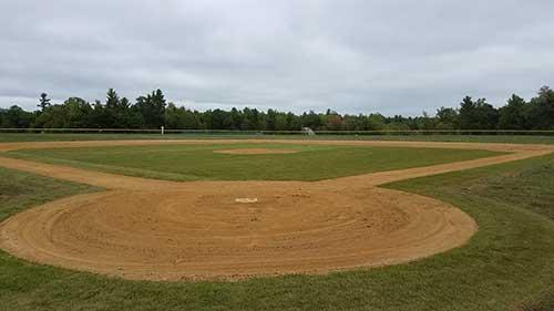 sod installation portfolio image of baseball field in Alton NH
