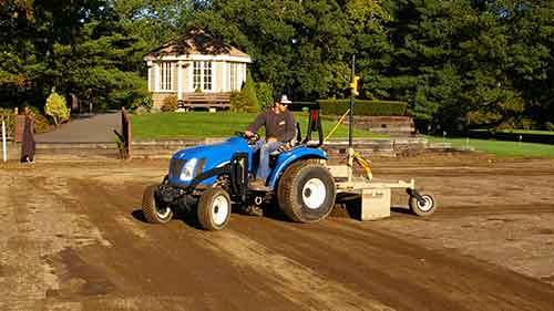 New Holland tractor with laser grading box