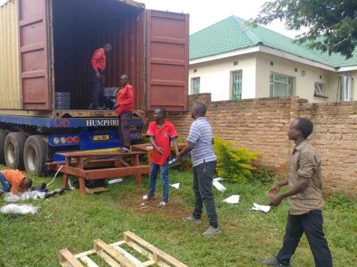 Truck is unloaded in Malawi.