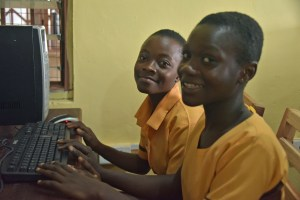Students at Abuontem JHS using their new computers