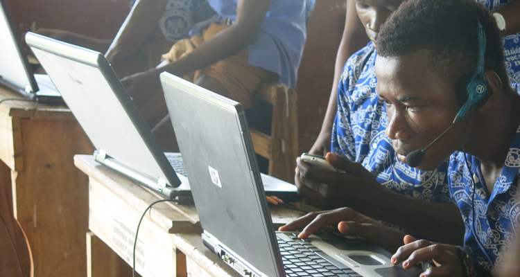 Student using a laptop at Otaakrom ICCES, Ghana