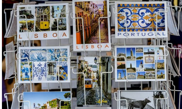 pb4 substitui seguro viagem em Portugal cartão postal