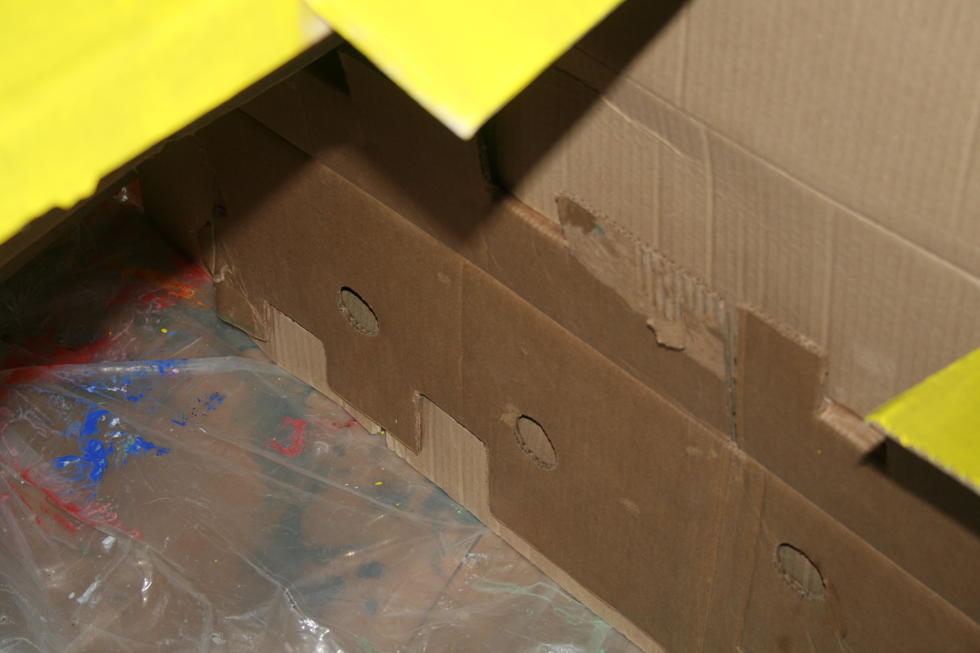 A look at how the car stays together- through joints that go through another layer of cardboard.