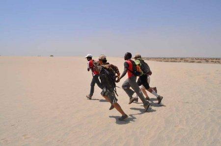 Luke, Quan, Johnpius Wyatt and Kasia race across the sand.