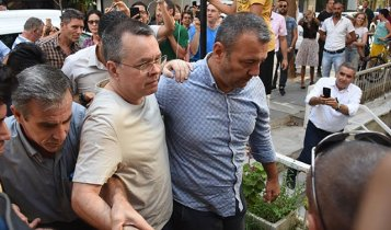 Pastor Brunson left prison on Wednesday in Izmir