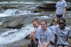 """Birmingham-Southern College Freshman volunteers enjoy the """"falls"""" after working to keep TCNP ecoscape clean and beautiful"""