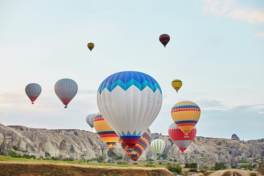 Hot air balloons fly in cappadocia