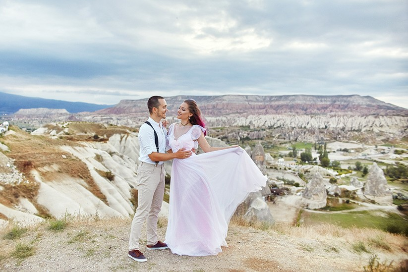 Valentine's day loving couple in nature hugs Mountains of Cappadocia in Turkey