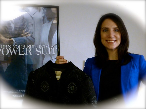 Stefanie L. Conley, Executive Director of Dress for Success Morris County, holding a Nanette Lepore jacket