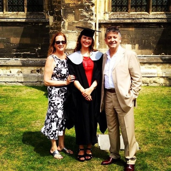 At graduation: Emilie-Rose with her parents. Her dress is