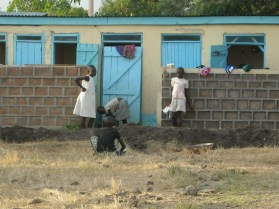 Outside the latrines