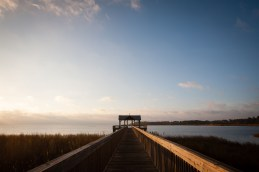 A pier stretches toward Mobile Bay as the sun rises in Mobile, Alabama