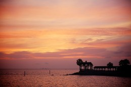 Sunset makes a brilliant sky after a gray day over Mobile Bay in Point Clear, Alabama, Saturday, May 11, 2013.