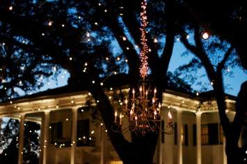 A chandelier hung from live oak trees lights up the evening sky at the Bragg-Mitchell Mansion in Mobile, Alabama