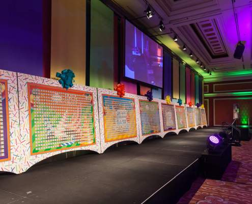 Custom created Satin Drapery Colorful Panels at an Event hung in alternating rainbow colors From Turn of Events Las Vegas Rental Drapery