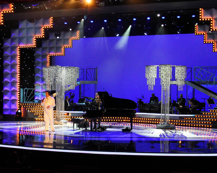 Liberace Impersonator on stage with LED Star Drop Drapery Background and flanking Free Standing Beaded Columns from Turn of Events Las Vegas