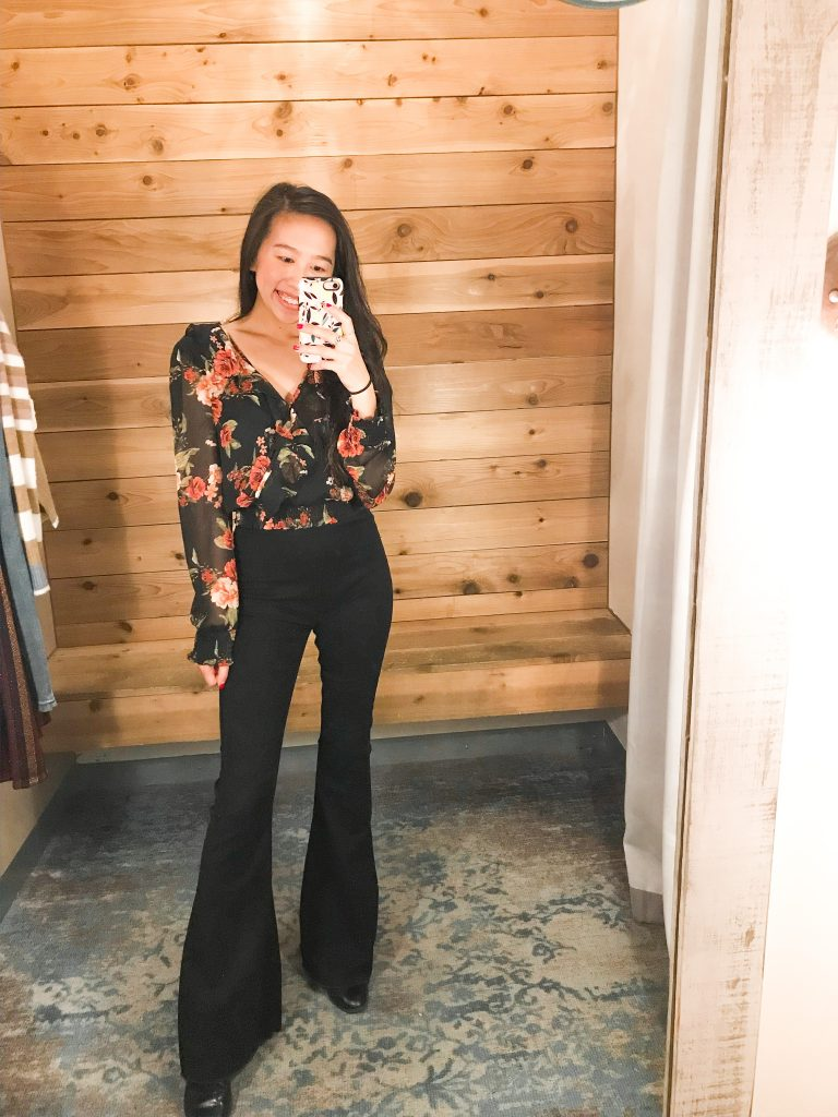 floral blouse and black flare jeans outfit