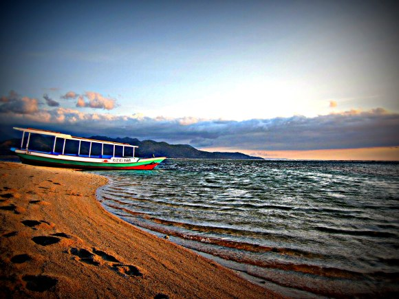 Boat on the shore, Gili Air. travel budget indonesia