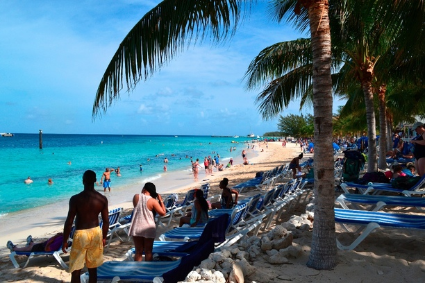 When I think of summer, I imagine a beautiful beach full of people enjoying themselves and having fun in the sun. This photo is of a perfect beach on Grand Turk island in the Turks and Caicos. Some enjoy the water, while others rest in the shade enjoying the sea breeze.